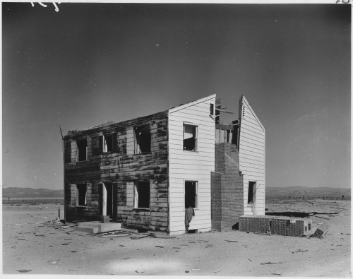 (Operation_Cue)_-_Two-story_wood_frame_house_at_5,500_feet_after_the_blast_-_NARA_-_541788.tif